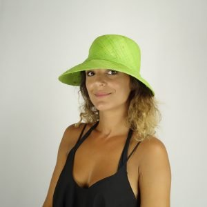 model with raffia green hat small size