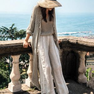 model with Handmade long cardigan with sleeves for woman made with natural fabric