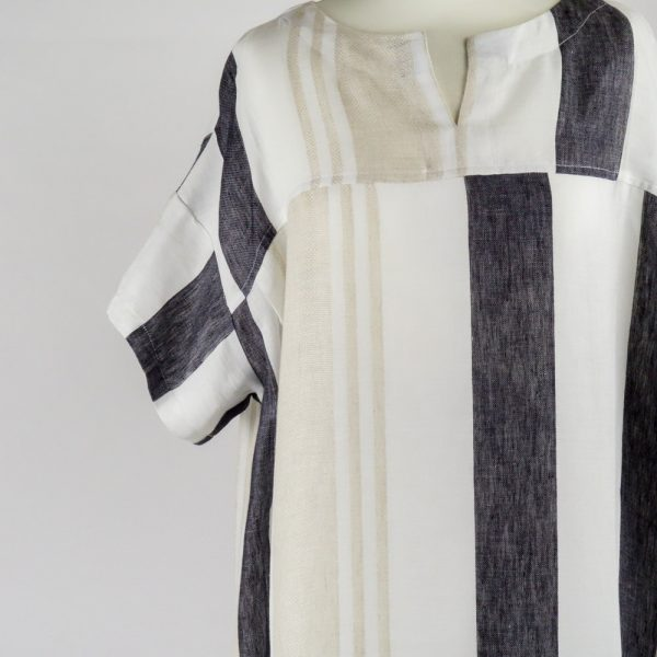 detail of handmade linen summer sleeves dress with stripes for woman