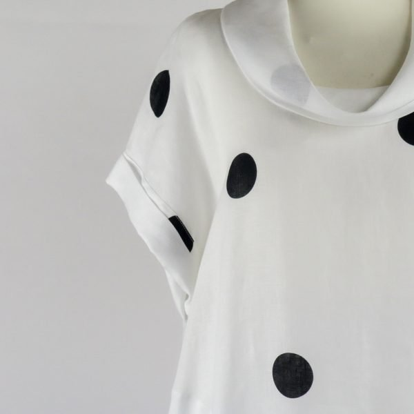 detail neck of handmade sleeves short white dress with dots for woman made with natural fabric