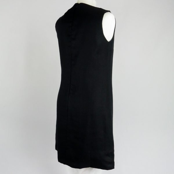 back of handmade sleeveless short black dress for woman made with natural fabric