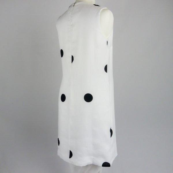 back of handmade linen summer sleeveless short white dress with dots for woman