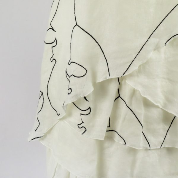detail of handmade linen dress with hand embroider for woman