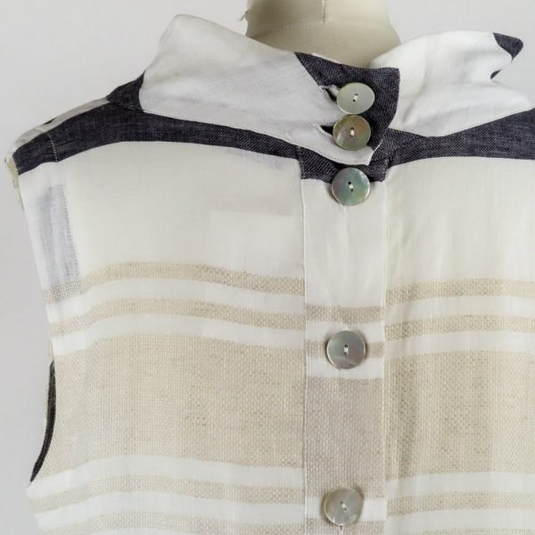 details buttons of handmade linen summer sleeveless dress with stripes for woman