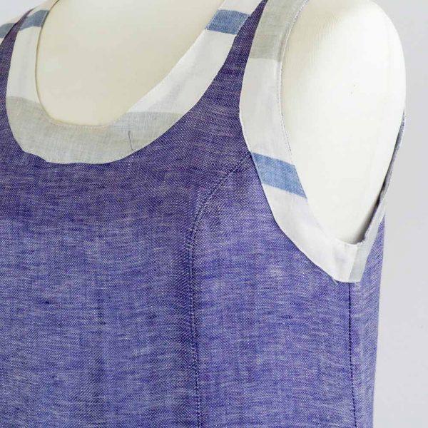 detail of handmade linen summer sleeveless short blue dress for woman