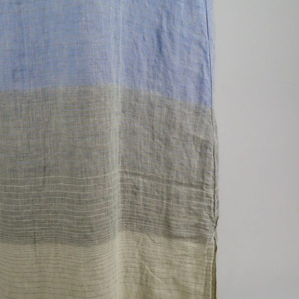 detail handmade dress with blue stripes for woman made with natural fabric