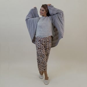 model with Handmade beige cardigan with sleeves for woman made with natural fabric