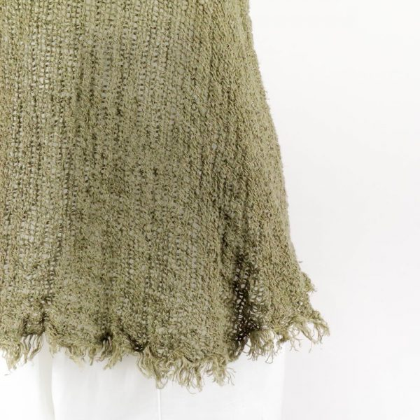 detail handmade green top for woman made with natural fabric