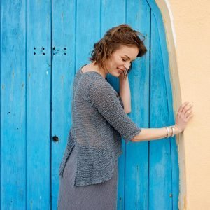 model with Handmade blue top with sleeves for woman made with natural fabric