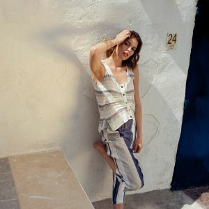 model with Handmade summer sleeveless top with blue stripes for woman made with natural fabric