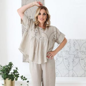 model with handmade summer sleeves top with hand embroider for woman made with natural fabric