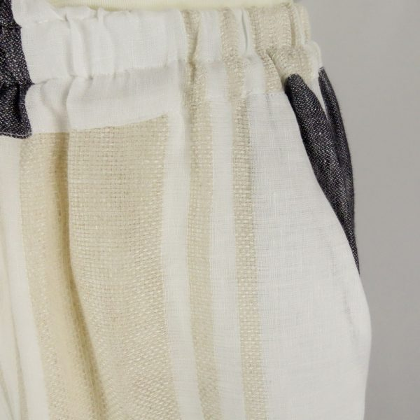 detail of handmade linen trousers with pocket for woman