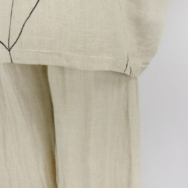 detail of handmade linen trousers and top for woman