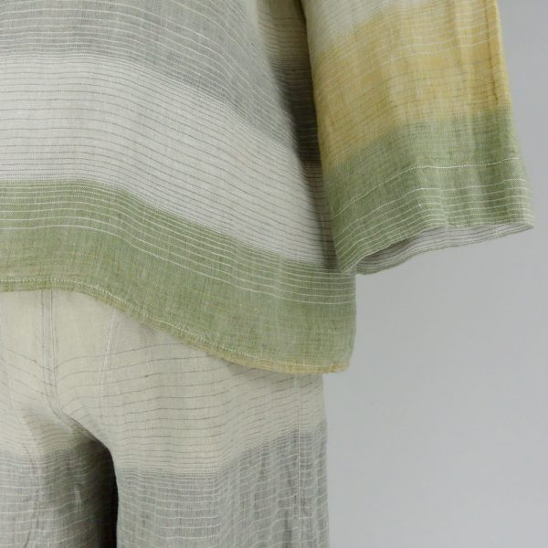 Detail of Handmade linen trousers and top with stripes for woman